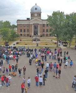 August's 2017 Celebration, far left: above, the opening of BNC National Bank's new branch on Crosby's Main Street; and, near left, a move out of City Hall in preparation for a remodeling project just nearing completion this month.