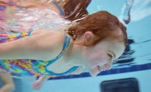 Aubrey Nygaard, above, in aquatic therapy; below, little clouds in the Missoula Children's Theater production.
